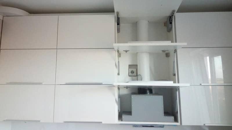 Как правильно установить вытяжку на кухне в квартире